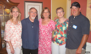Kent (second to the left) with his wife and three children celebrating his 70th birthday.